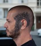 head tattoo around ear blue ink
