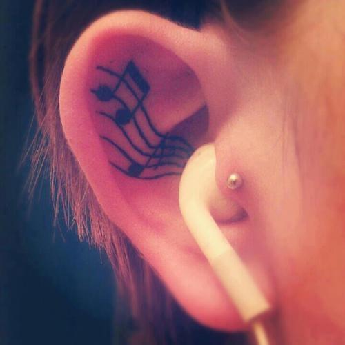 inside ear tattoo musical note