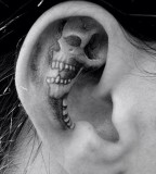 inside ear tattoo skeleton