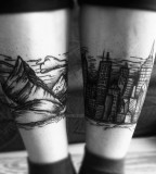 leg tattoo mountains and city