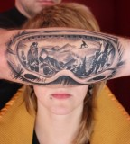 mountain reflection into ski goggles tattoo