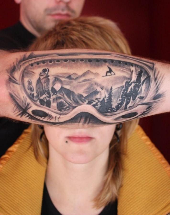 mountain reflection into ski goggles tattoo
