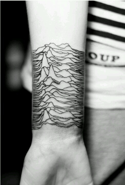 mountain relief tattoo on inside arm