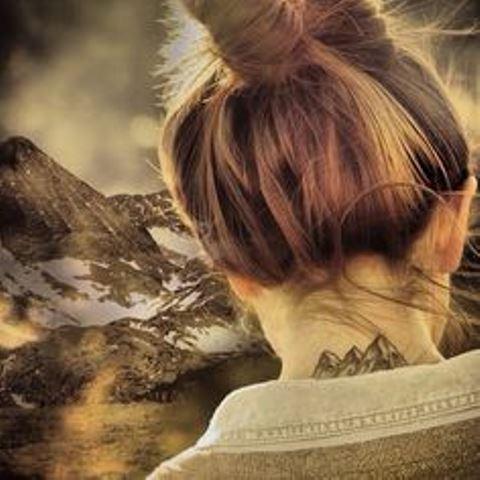 mountain tattoo on back neck