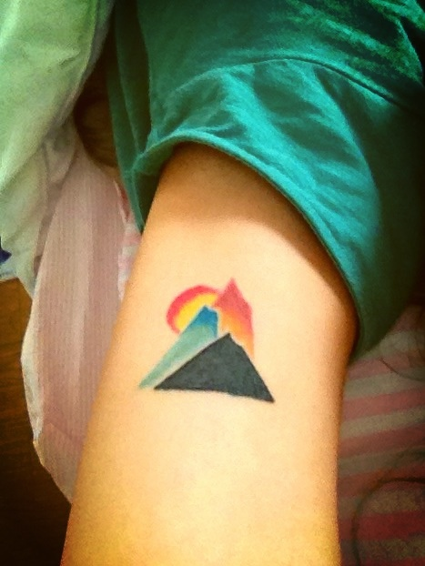mountains and sun tattoo