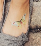 pastel butterfly tattoo