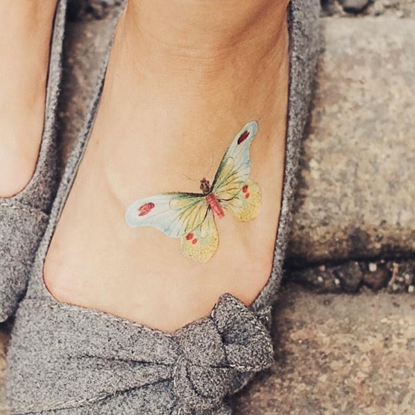 pastel butterfly tattoo