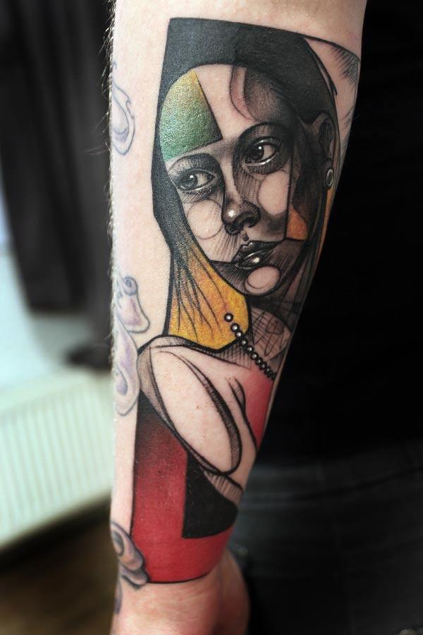 peter aurisch tattoo geometric girl on arm
