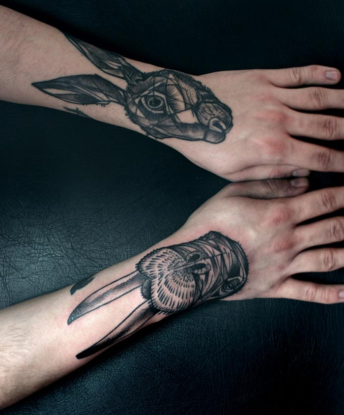 peter aurisch tattoo rabbits on arms
