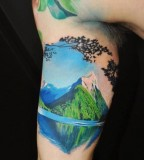 realistic mountain tattoo on arm