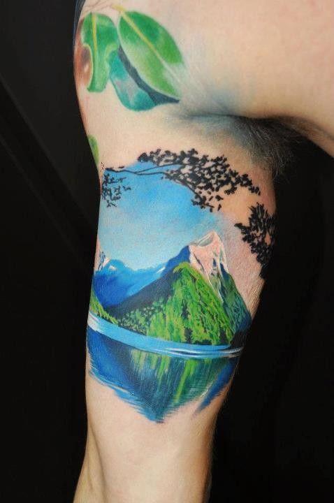 realistic mountain tattoo on arm