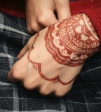 red wrist tattoo by henna