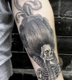 skeleton with big  hair tattoo by valentin hirsch