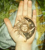 sun and moon on hand
