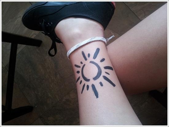 sun tattoo design painted sun