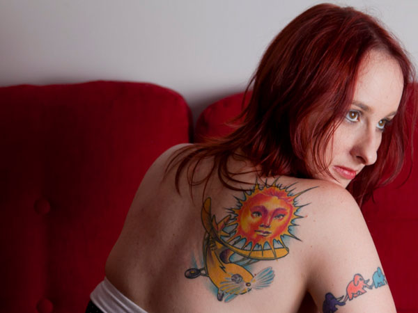 sun tattoo sunny delights red haired girl