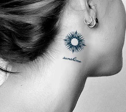 sun tattoo sunshine behind ear