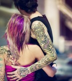 tattooed couple girl in pink