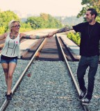 tattooed couple on rails