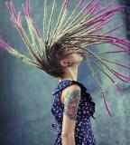 tattooed girl with dreadlocks colorful