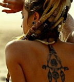 tattooed girl with dreadlocks dreamcatcher design