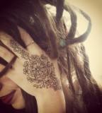 tattooed girl with dreadlocks hand tattoo