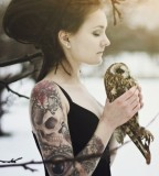 tattooed girl with dreadlocks holds owl winter
