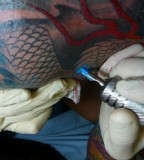 tattooing in process blue color