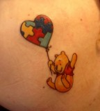 winnie the pooh and puzzle balloon tattoo