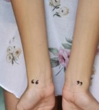 wrist tattoo quotation mark