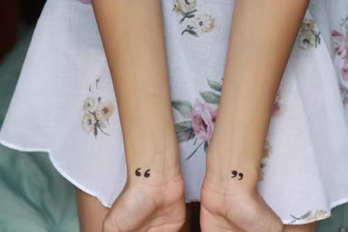 wrist tattoo quotation mark