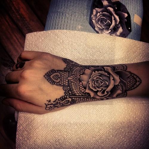 wrist tattoo rose