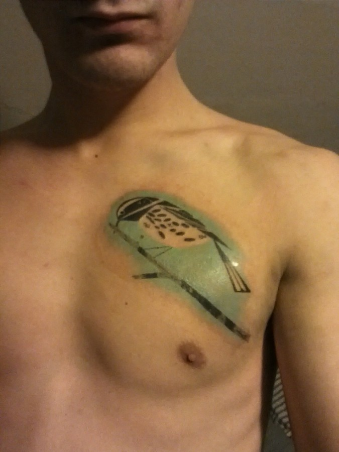 bird tattoo on chest inspired by charley harper