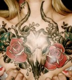 classic goat skull and rose tattoo on chest