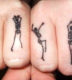 dancing skeletons tattoo sance moves finger tattoo