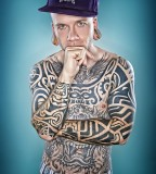fabrice petre tattoo photography guy with big flesh tunnels portrait