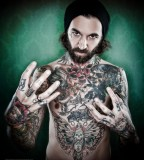 fabrice petre tattoo photography tattooed guy in green background