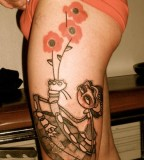 girl with red flowers tattoo by noon
