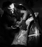 guy le tattooer working on full back piece