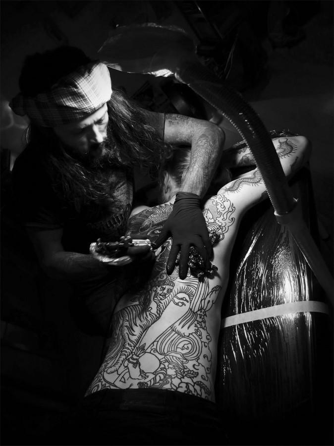 guy le tattooer working on full back piece