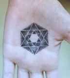 hand tattoo by diana katsko