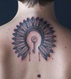 key and indian feather head piece tattoo by diana katsko