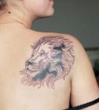 lion shoulder tattoo by diana katsko