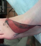 red bird tattoo on feet inspired by charley harper