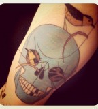 skull and birds tattoo inspired by charley harper