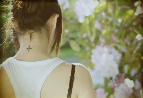 tiny black neck tattoo