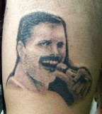 A very blurry Freddie Mercury tattoo