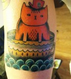 Awesome cat and cup tattoo