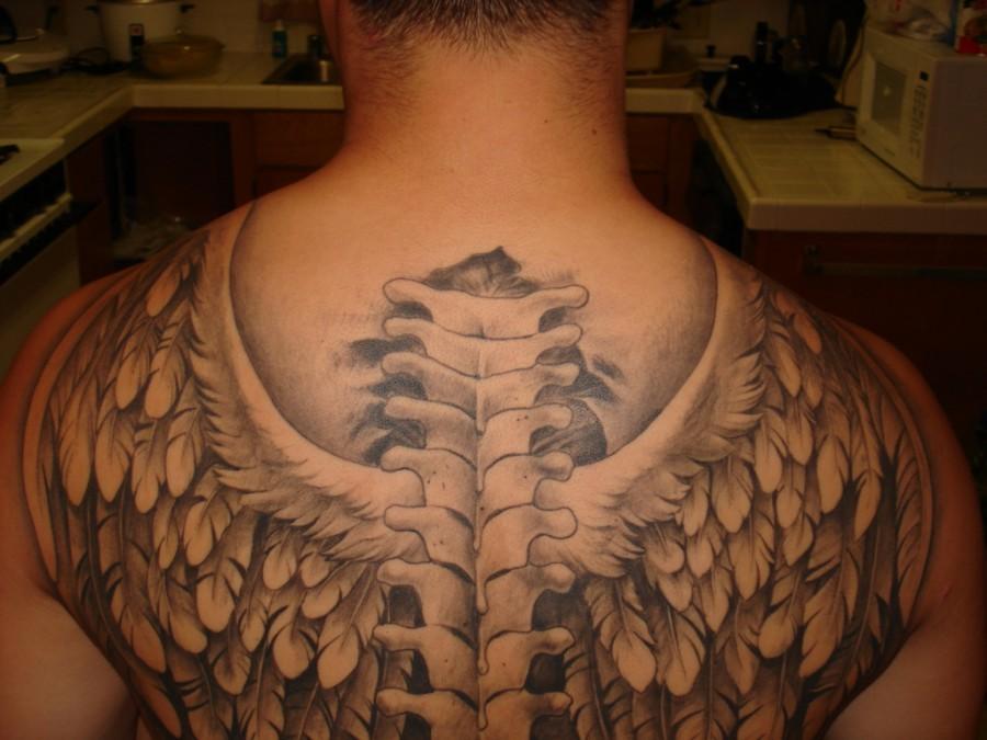 Back wings tattoo for men ,