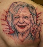 Betty White popping out of a bloody hole tattoo